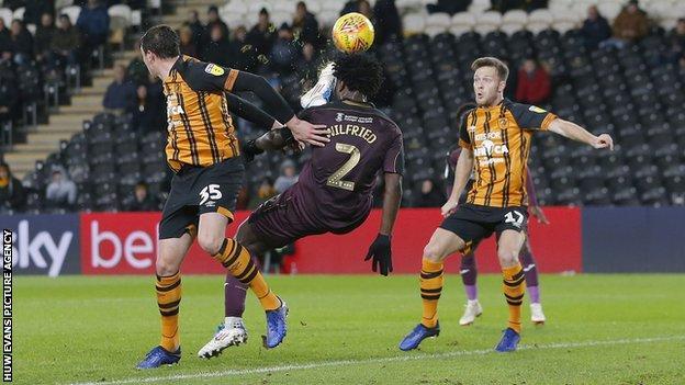 Swansea striker Wilfried Bony tries an overhead shot on goal against Hull