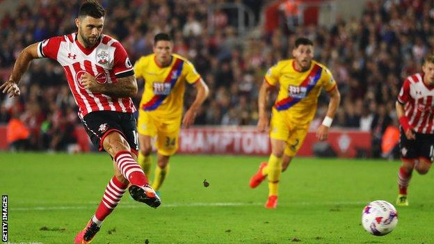 Charlie Austin scores from the penalty spot