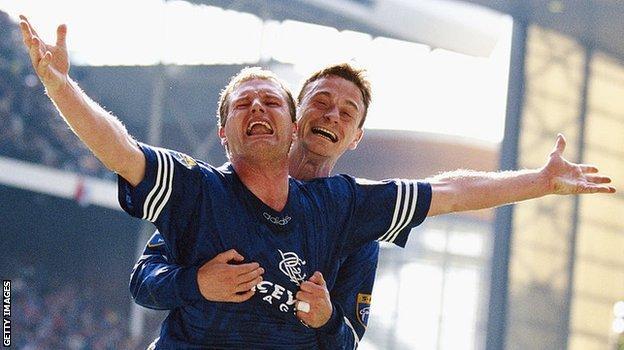 Paul Gascoigne celebrates a goal for Rangers with Davie Robertson