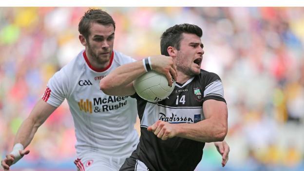 Tyrone's Ronan McNamee keeps tabs on Pat Hughes of Sligo during the All-Ireland qualifier tie on Saturday