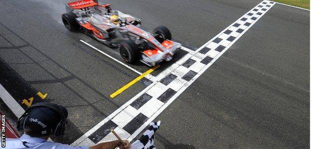 Lewis Hamilton crosses the finish line to win the 2008 British Grand Prix at the Silverstone