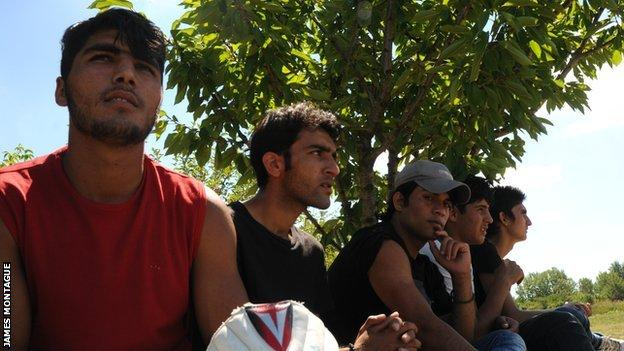 Refugees wait to bat at Belgrade's only cricket pitch