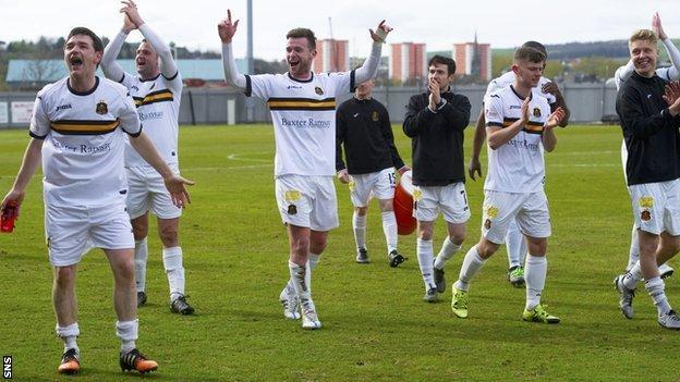 Dumbarton celebrate securing their Championship status