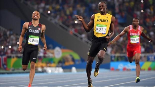 Usain Bolt and Camada's Andre De Grasse in Rio taking part in the 200m semi final on August 17 (Brazil time)