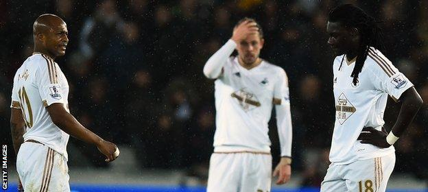 Andre Ayew, Gylfi Sigurdsson and Bafetimbi Gomis ponder Swansea's plight
