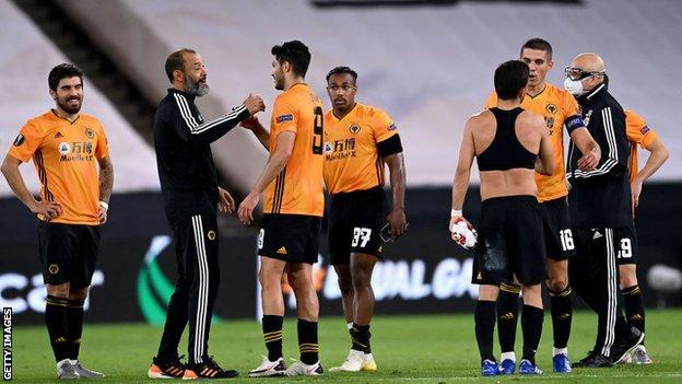 Wolves players celebrate beating Olympiakos