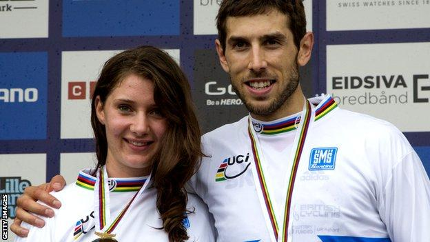 Gee Atherton (R) and Manon Carpenter celebrate winning the Elite Downhill class of the 2014 UCI Mountain Bike & Trials World Championships