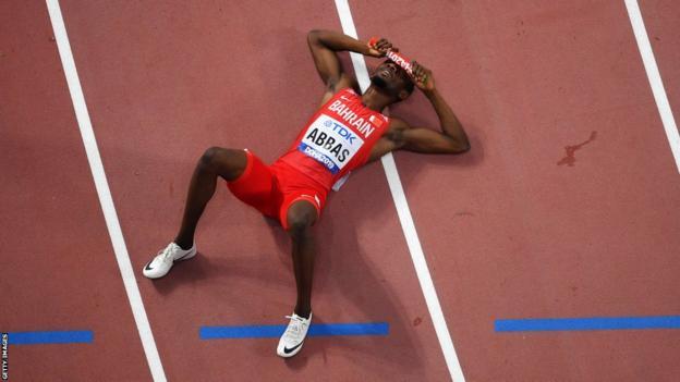 Nigeria-born Bahraini athlete Abbas Abubakar Abbas lying on the track after finishing a relay