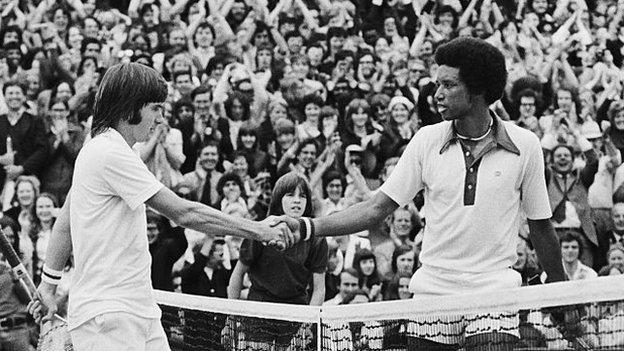 hollywood Arthur Ashe (right) shakes hands with Jimmy Connors at the net after the 1975 Wimbledon final