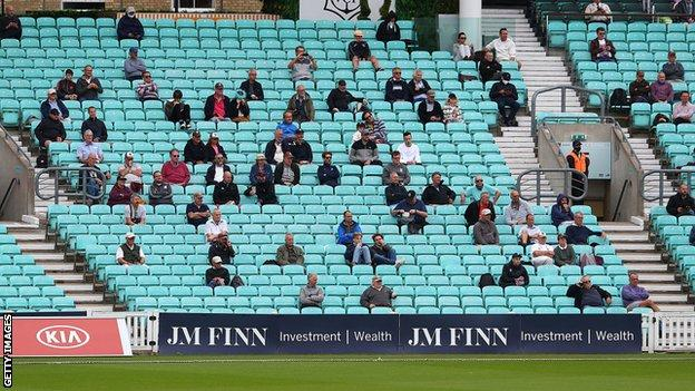 Socially-distanced cricket fans watch Surrey take on Middlesex at The Oval - how football stadiums could look next season