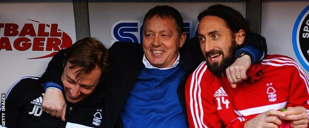 Nottingham Forest manager Billy Davies jokes with coach Julian Darby and Jonathan Greening