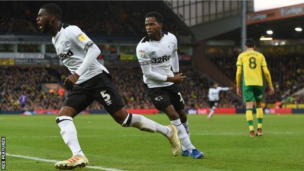 Fikayo Tomori (right) celebrates his first-half goal against Norwich