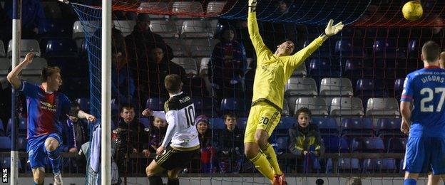 Carl Tremarco (left) scores Inverness' third goal