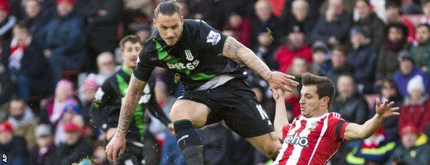 Marko Arnautovic gets a shot away under pressure from Cedric Soares
