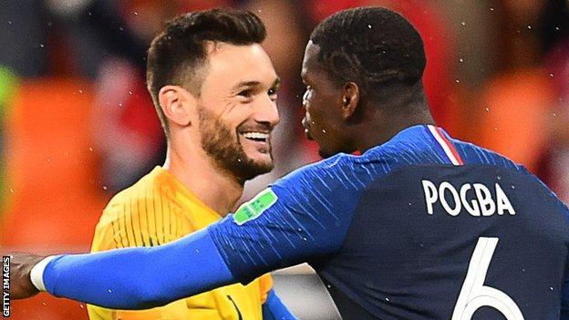 Hugo Lloris embraces Paul Pogba
