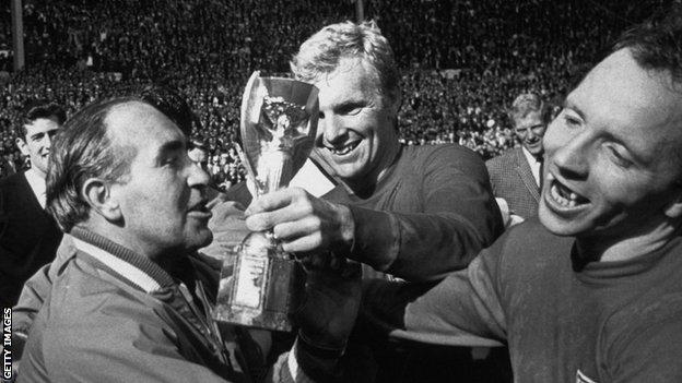 Sir Alf Ramsey, Bobby Moore and Nobby Stiles celebrate World Cup victory