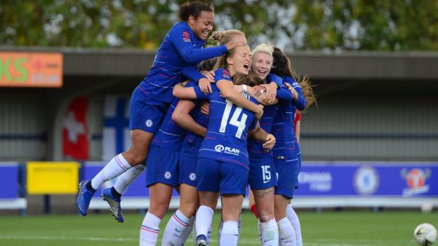 Magdalena Eriksson of Chelsea celebrates with her team-mates after she scores an overhead kick to put her side 1-0 up against Liverpool Ladies in the WSL