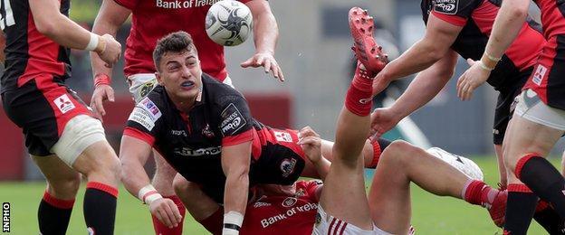 Damien Hoyland is brought down for Edinburgh against Munster