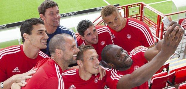 Hamilton manager Martin Canning poses with new signings Chris Turner, Lucas Tagliapietra, Alan Martin, Carlton Morris, Antons Kurakins and Christian Nade