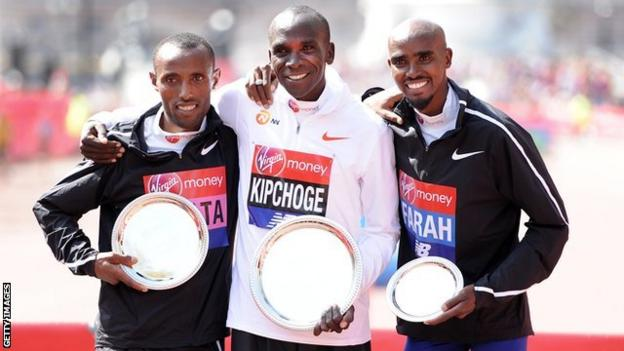 Second placed Tola Shura Kitata of Ethiopia, winner Eliud Kipchoge of Kenya and third placed Mo Farah of Great Britain