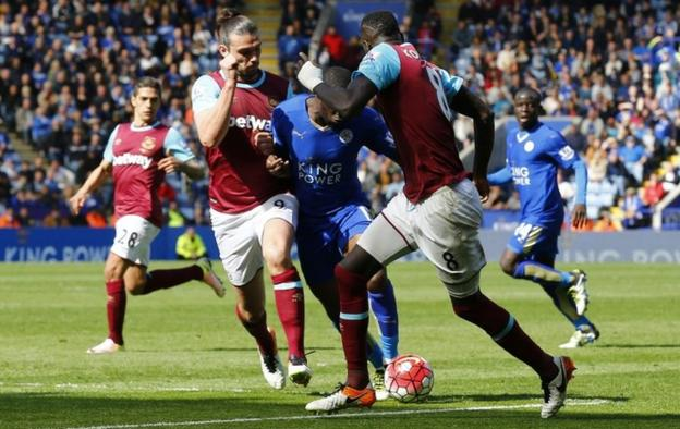 Andy Carroll challenges Jeffrey Schlupp in the incident that led to Leicester's penalty