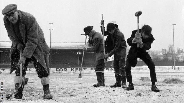 Workmen trying to crack the ice on the Gravesend and Northfleet pitch in preparation for an FA Cup tie with Sunderland in 1963