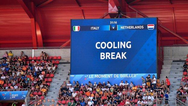 Image of big screen in stadium showing cooling break alert