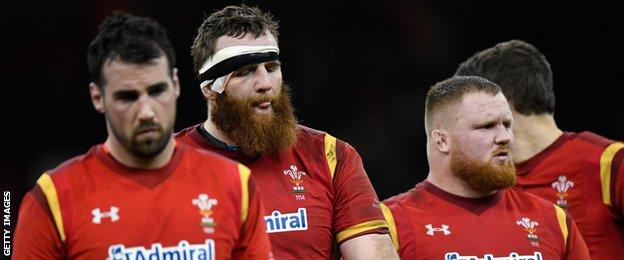 Dejected Wales players including Jake Ball leave the field after the RBS Six Nations match between Wales and England