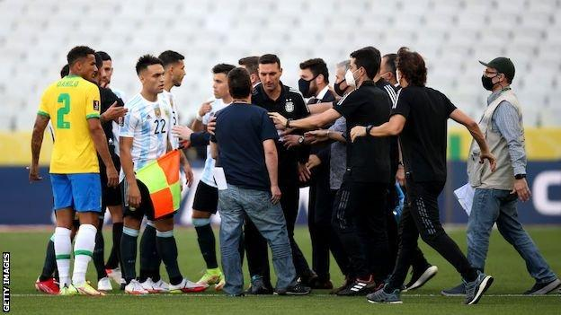 Officials stop play during Brazil v Argentina