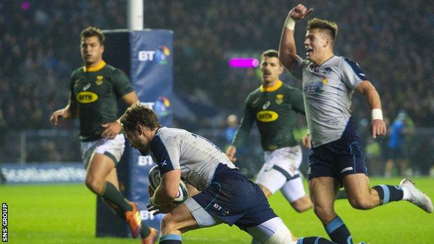 Peter Horne scored a stunning opening try for Scotland, after brilliant play by Huw Jones (right)