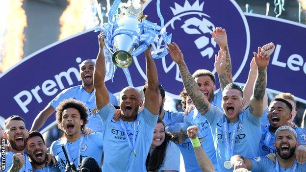 Manchester City captain Vincent Kompany holds up the Premier League trophy