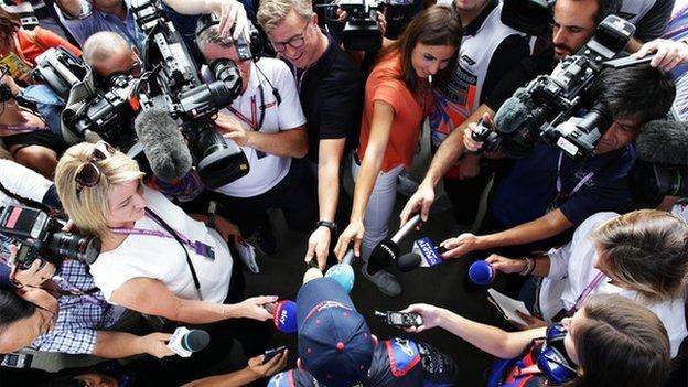 Scuderia Toro Rosso Naoki Yamamoto driver surrounded by journalists in a huddle