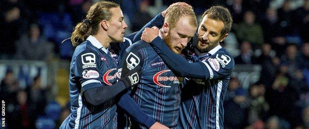 Liam Boyce (centre) is congratulated after netting a late penalty