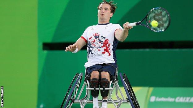 Gordon Reid of Great Britain returns a shot at the Men's Singles Wheelchair Tennis gold medal match at the Rio Paralympic Games