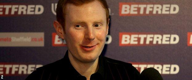 Anthony McGill smiles as he speas to the media after his win over Shaun Murphy