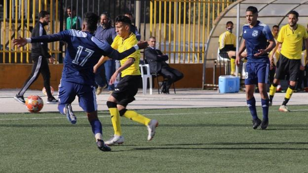 Action from Shabab Aljabal (in blue) against Darnes in the Libyan league