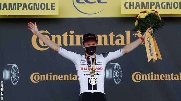 Sunweb's Soren Kragh Andersen celebrates on the podium after winning stage 19 of the 2020 Tour de France
