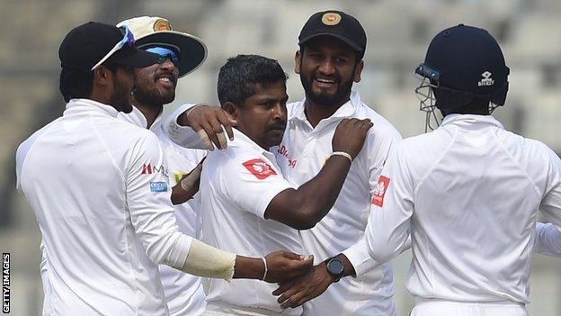 Rangana Herath (centre) celebrates a wicket