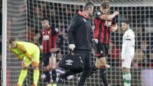 Bournemouth captain Simon Francis going off injured