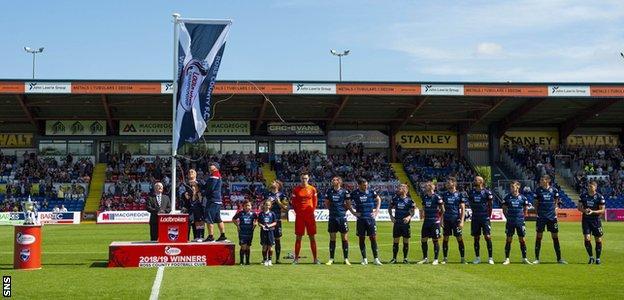 Ross County unfurl the Scottish Championship flag
