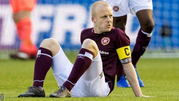 Steven Naismith looks dejected as he awaits treatment on the pitch