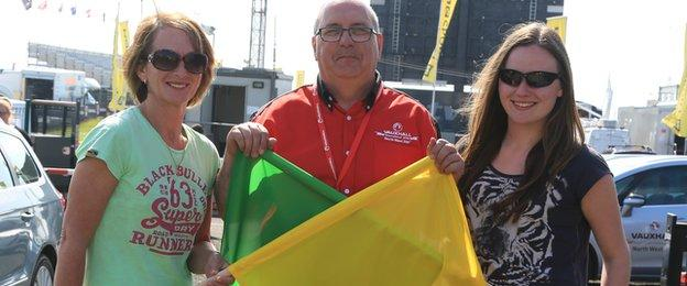 Florence Burns with Chief Flag Marshal Keith Edgar and her daughter Naomi at the North West 200
