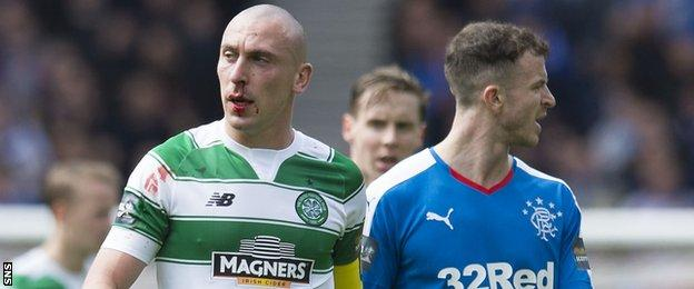Celtic's Scott Brown (left) sports a bloody nose against Rangers