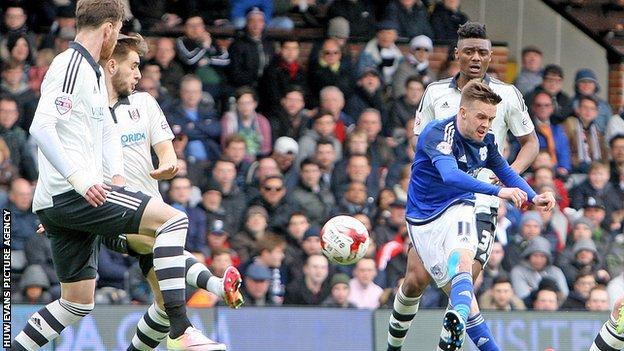 Craig Noone has a shot on goal against Fulham