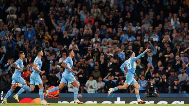 Jack Grealish celebrates scoring Manchester City's fourth goal against RB Leipzig