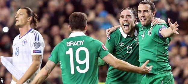 Robbie Brady, Richard Keogh and John O'Shea celebrate the Republic of Ireland reaching Euro 2016