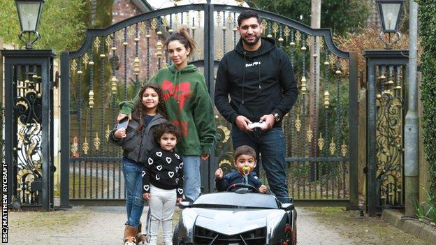 Faryal Makhdoom, Amir Khan and three children outside their home in Bolton.