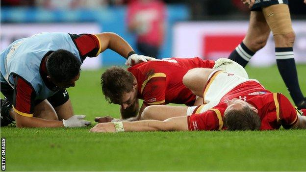 Liam Williams and Dan Biggar receive treatment during Wales' World Cup 2015 match against England.