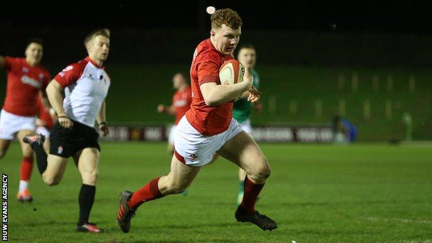 Aneurin Owen runs in to score a try