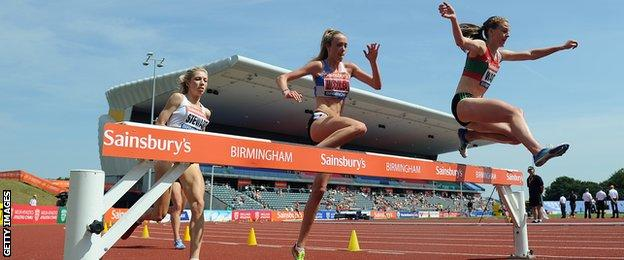 Eilish McColgan competing in a steeplechase event